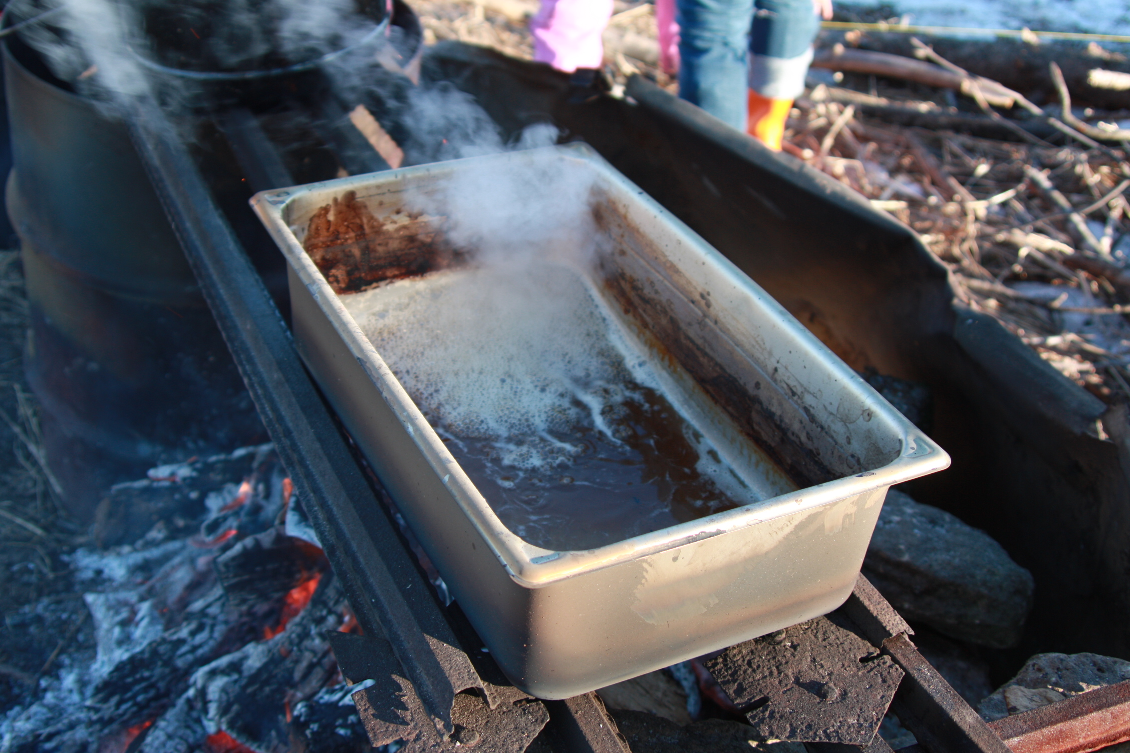 An evaporation system does not have to be fancy. This was one I made out of a fire pit and some steel posts to hold the grate and pan.